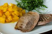 Grilled meat with pumpkin and ruccola