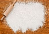 pic of insert  - White flour on a wooden table creating a text area for insertion of your custom message or recipe - JPG