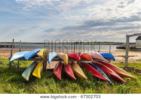 Colorful kayaks stored along the shore in North Rustico, Prince Edward Island, Canada