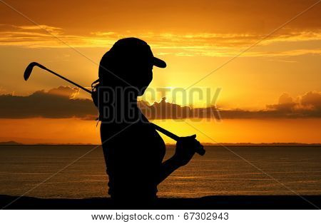 Woman playing golf on a nice day
