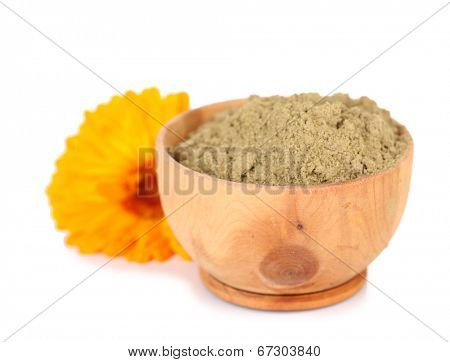 Dry henna powder in bowl, isolated on white