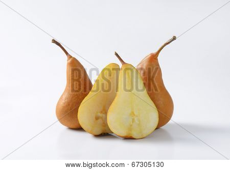 side view of four pieces of halved pears