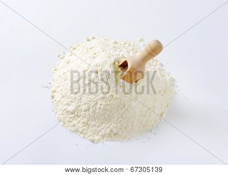 overhead view of all-purpose flour with immersed measuring spoon