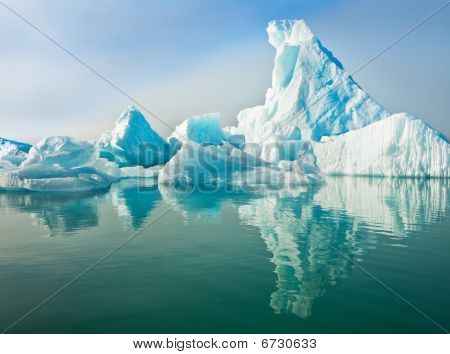 Icebergs Floating In Calm Water