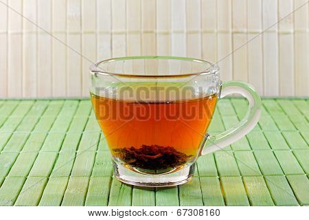 Cup Of Tea In Front Of A Straw Mat
