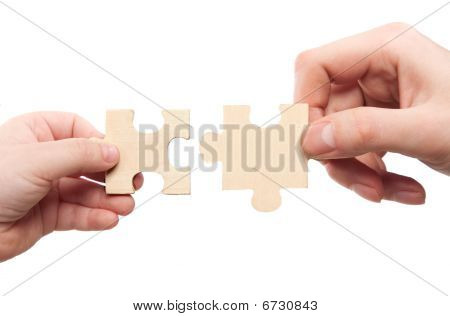 Mens And Childs Hands Connecting Puzzles