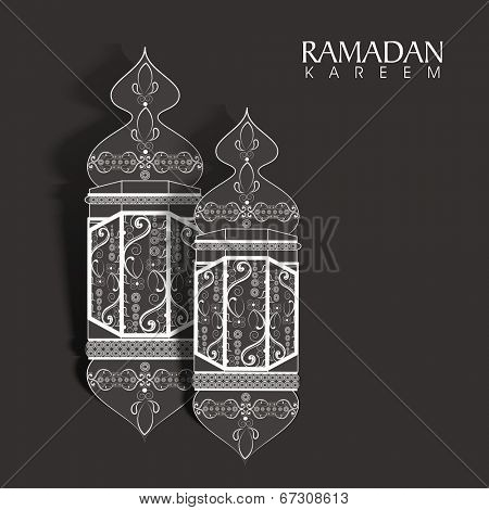 Arabic intricate lanterns on grey background for holy month of Muslim community Ramadan Kareem.