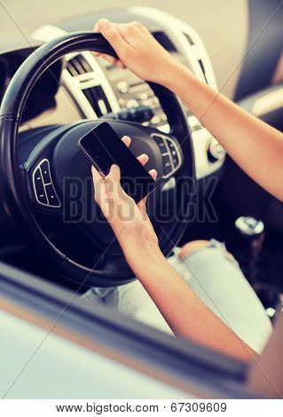transportation and vehicle concept - woman using phone while driving the car