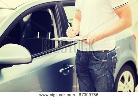 transportation and ownership concept - man with car documents