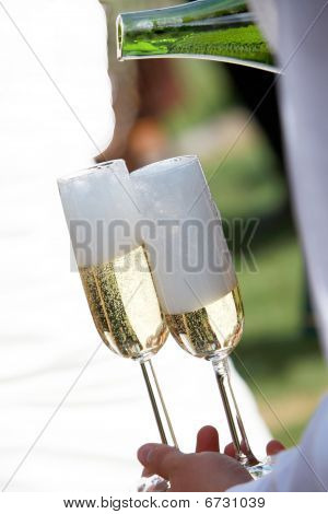 A Waiter Filled Champagne Glasses