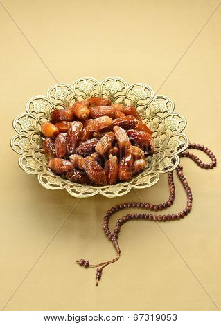 Islamic rosary and ornate bowl of dates