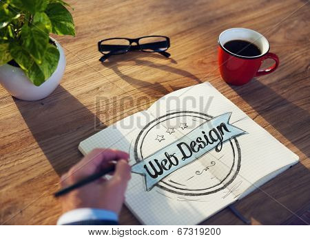 Man with a Note Pad and Web Design Concept