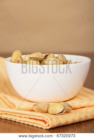 Faience bowl with pistachios