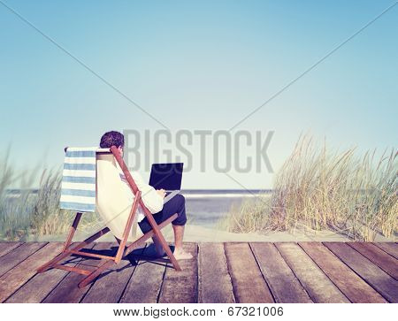 Businessman Working by the Beach