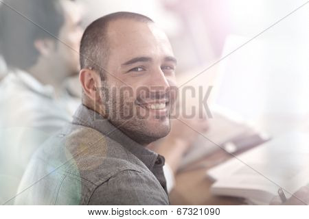 Smiling guy in business training attending meeting
