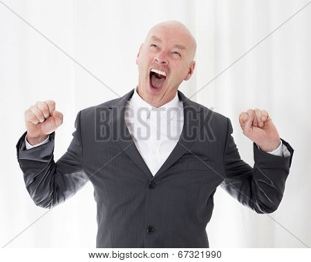 Man In A Suit Yawning