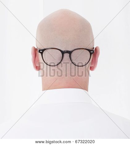 Back Of A Bald Head With Glasses