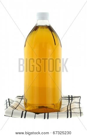 A bottle of filtered Apple Cider Vinegar isolated on white