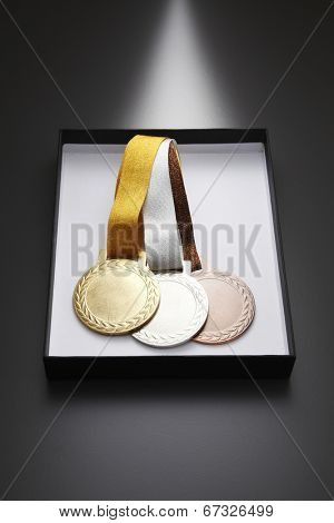 gold,silver and bronze medal in a box
