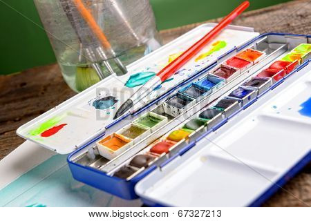 Professional watercolor aquarell paints in box with brush