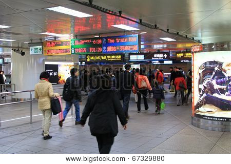 TAIPEI, TAIWAN - JANUARY 4 2012 : People use the service of The Taipei Metro Rapid Transit  (MRT) at the Taipei station in Taipei on January 4, 2012