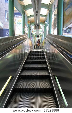HONG KONG ISLAND, CHINA - DECEMBER 30 2013 : People using the Centra Mid-Levels escalator in Hong Kong on December 30, 2013. It is the longest outdoor covered escalator system in the world.