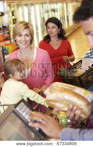People at supermarket checkout