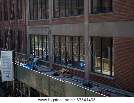 A Construction Worker Atop Scaffolding Near The High Line In New York City