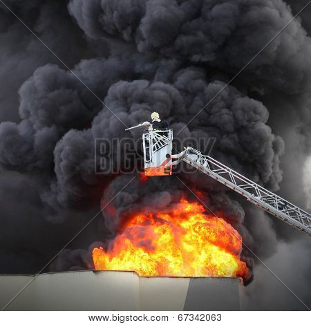 Firefighter and burning house.