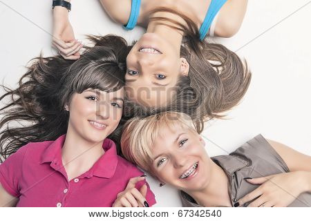 Portrait Of Happy Caucasian Girls Wearing Teeth Braces