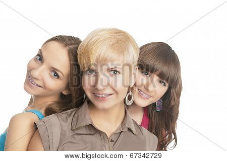 Portrait Of Three Young And Positive Caucasian Girls Teeth Braces Together