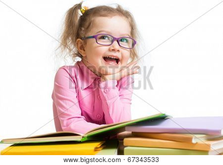 Funny kid girl in glasses reading books