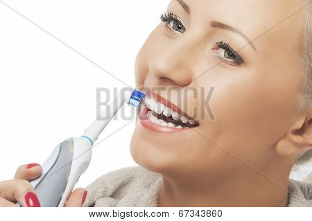 Dental Hygiene Concept:caucasian Woman Face Closeup Brushing Her Teeth With Modern Electric Toothbru