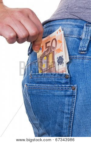 the hand of a young woman pulling a euro-bill from the pocket of her jeans