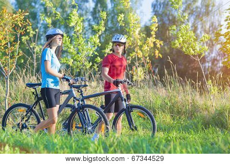 Cycling Athlets Exercising With Bicycles In Nature Environment Outdoor