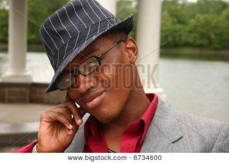 Man With Hand On Side Of Face