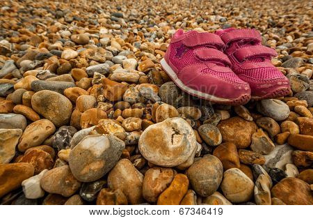 Shoes on pebbles