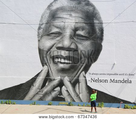 Unidentified child in the front of the Nelson Mandela mural