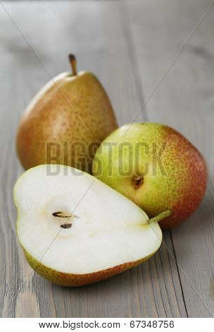 Forelle Pears With Half On Wood Table
