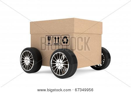 Logistics, Shipping And Delivery Concept. Cardboard Box With Wheels