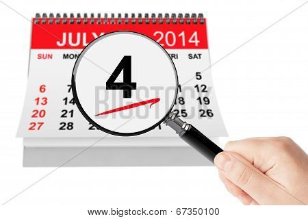 American Independence Day Concept. 4 July 2014 Calendar With Magnifier