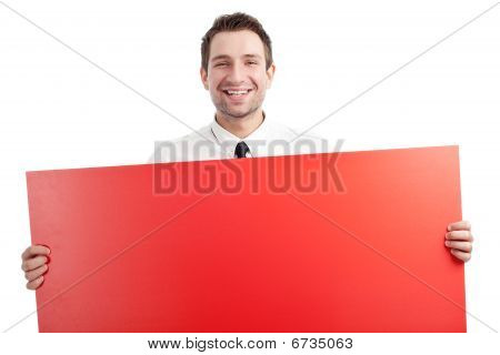 Young Businessman With Red Blank Sign Smiling