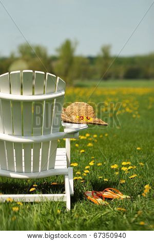 Adirondack chair with summer hat