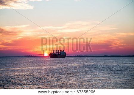 Purple Sunset With Empty Freighter