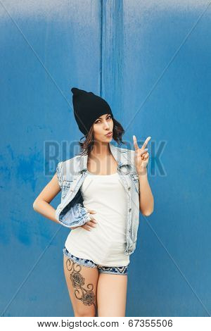 Cute Hipster Teenage Girl With Black Beanie Hat And Tattoo On Leg