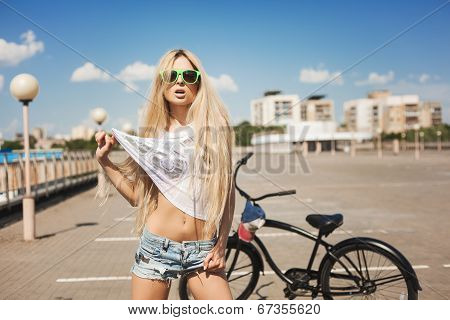 Beautiful Young Woman With Bike Outdoors