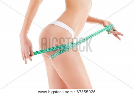 woman measuring leg hip with measurement tape