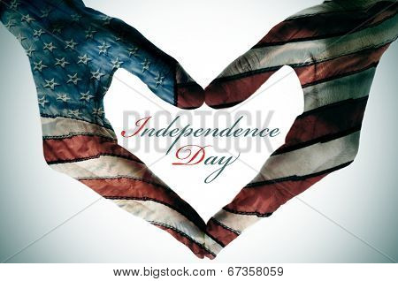 man hands patterned with the flag of the United States forming a heart and the sentence independence day