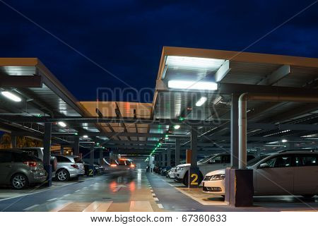 VALENCIA, SPAIN - JUNE 25, 2014: Inside the parking garage at the Valencia airport.  Situated 8 km from the city it is the 8th busiest Spanish airport with flight connections to 15 European countries.
