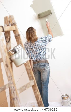 Home Improvement: Blond Woman Painting Wall